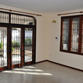 Living Room Rental Standalone House in Masaki by Tanaganyika Estate Agents