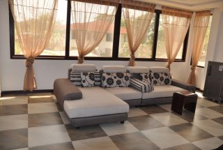 Sitting Room Furnished Villa on Toure Drive in Masika by Tanganyika Estate Agents