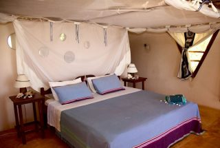 A Bedroom of the Eco Friendly Lodge for Sale, Dar es Salaam by Tanganyika Estate Agents