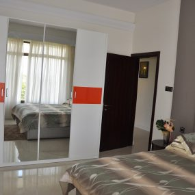 A Bedroom of the Two Bedroom Furnished Apartments in Masaki by Tanganyika Estate Agents