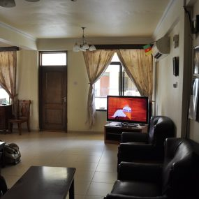 The Living Room of the Three Bedroom Furnished Apartments Masaki by Tanganyika Estate Agents