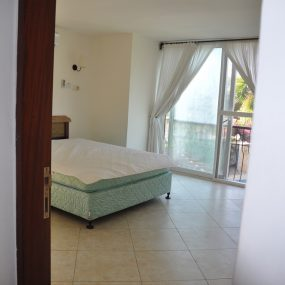 A Bedroom of the One Bedroom Furnished Apartments in Masaki by Tanganyika Estate Agents