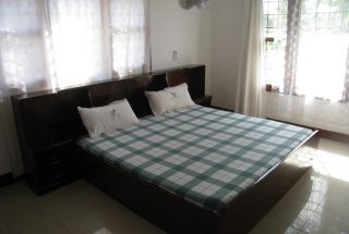 One of the Bedrooms of the Three Bedroom Home Rental on Kimandolu Hill, Arusha by Tanganyika Estate Agents