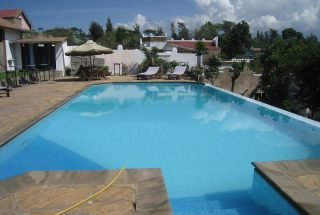 The Swimming Pool of the Two Bedroom Furnished House in Sakina, Arusha by Tanganyika Estate Agents