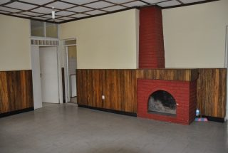 Living Room with Fireplace of the Three Bedroom Rental Home in Themi Hill, Arusha by Tanganyika Estate Agents
