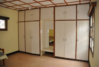 Inbuilt Wardrobes of a Bedroom in the Three Bedroom Rental Home in Themi Hill, Arusha by Tanganyika Estate Agents