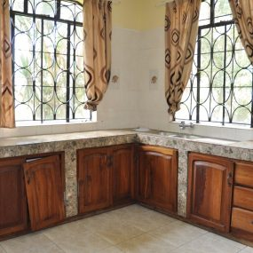 The Kitchen of the 4 Bedroom Furnished Apartment in Sakina by Tanganyika Estate Agents