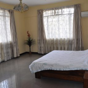 A Bedroom of the 4 Bedroom Furnished Apartment in Sakina by Tanganyika Estate Agents