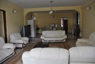 Living Room of the 4 Bedroom Furnished Apartment in Sakina by Tanganyika Estate Agents