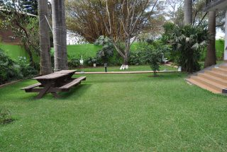 The Lawn of the 4 Bedroom Furnished Apartment in Sakina by Tanganyika Estate Agents