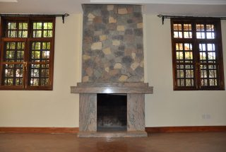 The Fireplace in the Living Room of the Four Bedroom House for Rent in Njiro AGM in Arusha by Tanganyika Estate Agents