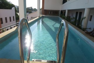 Communal Swimming Pool of the One bedroom Fully Serviced Apartment in Oyster bay by Tanganyika Estate Agents