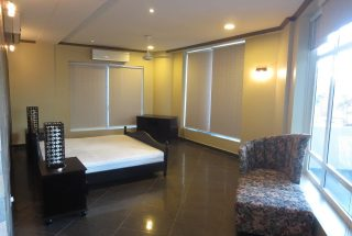 A Bedroom of the 3 Bedroom Furnished Apartments in Masaki by Tanganyika Estate Agents