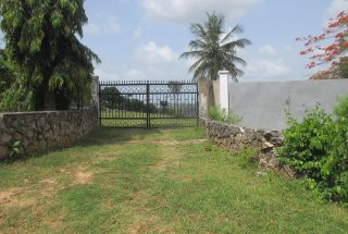 The Gate to the Land for Sale in Tanga by Tanganyika Estate Agents