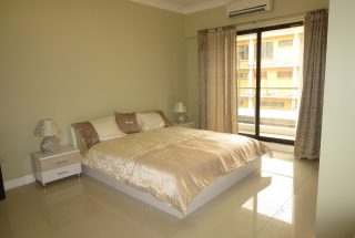 A Bedroom in the 2 Bedroom Furnished Apartments in Masaki by Tanganyika Estate Agents