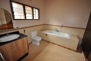 A Bathroom of the Four Bedroom Furnished House in Olorien by Tanganyika Estate Agents