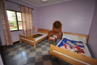 The Bedroom of the Four Bedroom Furnished House in Olorien by Tanganyika Estate Agents
