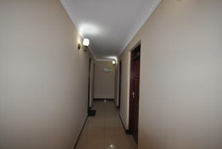 A corridor of the Three Bedroom Furnished Houses in Arusha by Tanganyika Estate Agents