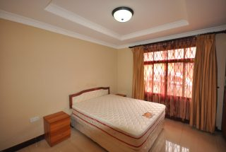 A Bedroom of the Three Bedroom Furnished Houses in Arusha by Tanganyika Estate Agents