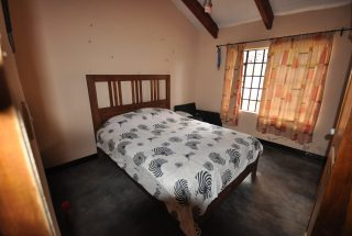 A Bedroom of the Park 5 Bedroom Property for Sale Near Arusha National Park by Tanganyika Estate Agents