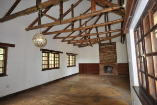 Living Room with Fireplace of the House for Rent by Tanganyika Estate Agents