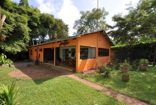 The Side View of the 2 Bedroom Cottage for Sale in Sakina, Arusha by Tanganyika Estate Agents