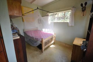 A Bedroom of the 7 Bedroom Home for Sale in Mateves, Arusha by Tanganyika Estate Agents