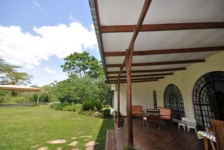 The Lawn & Veranda of the 5 Bedroom Home for Rent in Usa River by Tanganyika Estate Agents
