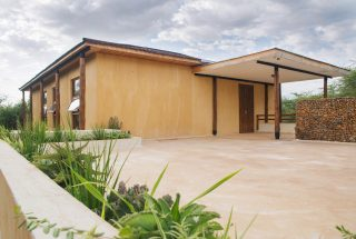 Side View with Door of the Three Bedroom House on Kilimanjaro Golf and Wildlife Estate by Tanganyika Estate Agents