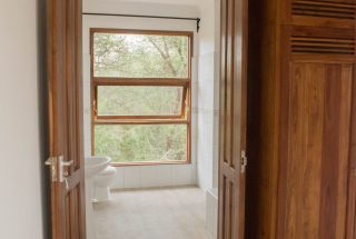 A Bathroom in the Three Bedroom House on Kilimanjaro Golf and Wildlife Estate by Tanganyika Estate Agents