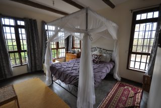 A Bedroom of the 2 Bedroom Home for Sale in Olasititi, Arusha by Tanganyika Estate Agents