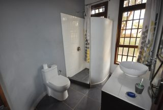 A bathroom of the 2 Bedroom Home for Sale in Olasititi, Arusha by Tanganyika Estate Agents
