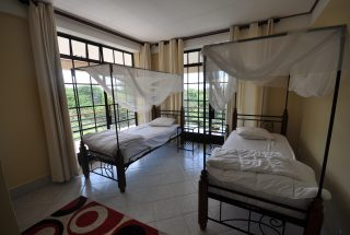 A Double Bed Room of the Commercial Property for Rent in Usa River, Arusha by Tanganyika Estate Agents