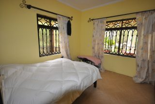One of the Bedrooms of the Furnished House in Ngaramtoni by Tanganyika Estate Agents