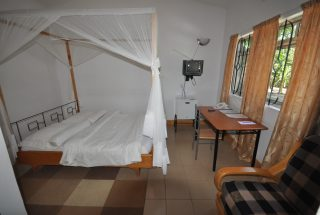 One of the Bedrooms of the 17 Room Lodge for Sale in Usa River, Arusha by Tanganyika Estate Agents