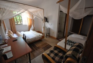 A Bedroom of the 17 Room Lodge for Sale in Usa River, Arusha by Tanganyika Estate Agents