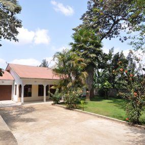 Garden & Front View of the Three Bedroom Home for Rent by Tanganyika Estate Agents