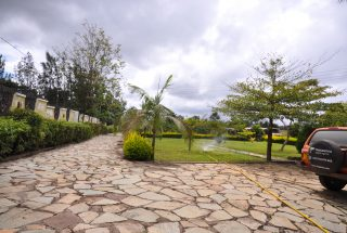 Parking & Lawn of the Four Bedroom House in Mateves, Arusha by Tanganyika Estate Agents