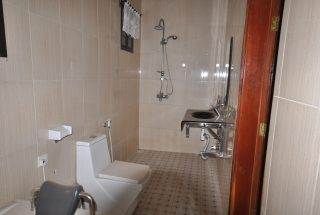 Bathroom with Shower of the Four Bedroom House in Mateves, Arusha by Tanganyika Estate Agents