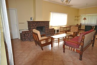 The Living Room with Fireplace of the Four Bedroom House for Rent in Corridor Area in Arusha by Tanganyika Estate Agents