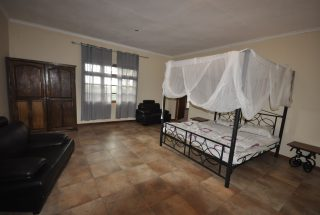 A Furnished Bedroom of the Three Bedroom Furnished Home by Tanganyika Estate Agents