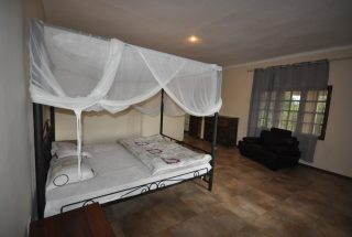 One of the Furnished Bedroom of the Three Bedroom Furnished Home by Tanganyika Estate Agents