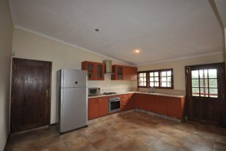 The Furnished Kitchen of the Three Bedroom Furnished Home by Tanganyika Estate Agents