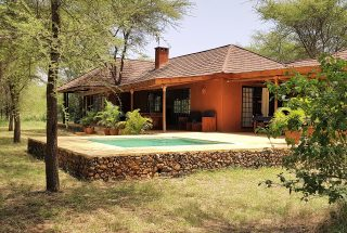 Side view of the pool of the Four Bedroom House for Sale in Kili Golf, Arusha by Tanganyika Estate Agents