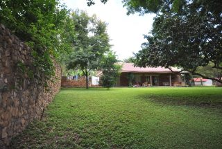 The Well Kept Lawn of Three Bedroom House in Usa River's Dolly Estate Arusha by Tanganyika Estate Agents