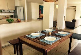 The Dining Room of the Four Bedroom Furnished Ensuite Apartment in Dar